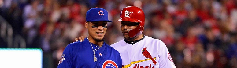 Cubs infielder Javier Baez, left, and Cardinals catcher Yadier Molina