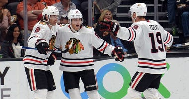 Blackhawks right wing Patrick Kane (88) celebrates his overtime goal against the Ducks with defenseman Duncan Keith (2) and center Jonathan Toews (19).