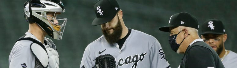 White Sox left-hander Dallas Keuchel (60) is pulled from the game by manager Rick Renteria.