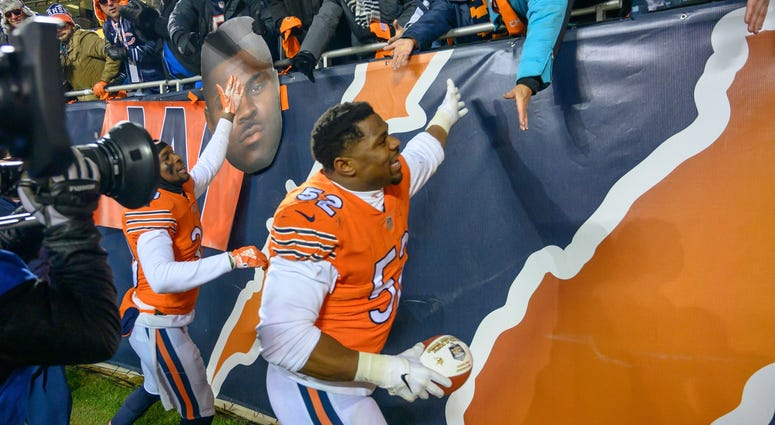 Bears linebacker Khalil Mack (52) celebrates with fans after a win against the Vikings.