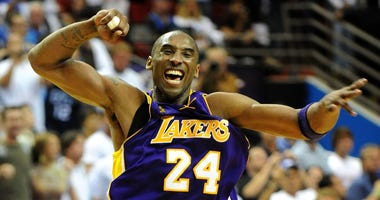 Kobe Bryant celebrates after the Lakers defeated the Magic to win the NBA Finals in 2009.