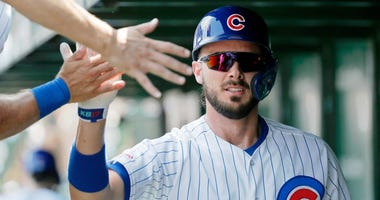 Kris Bryant is congratulated by Cubs teammates after homering.