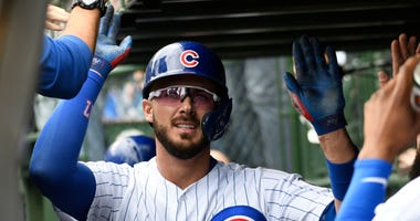 Kris Bryant celebrates with Cubs teammates after homering.