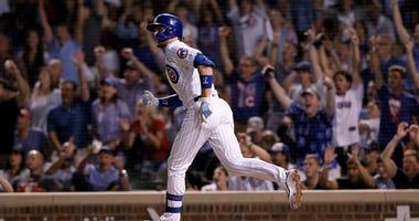 Cubs third baseman Kris Bryant watches his go-ahead homer against the Giants.