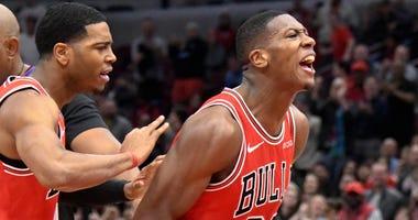 Bulls point guard Kris Dunn, right
