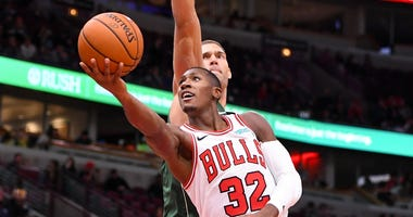 Bulls point guard Kris Dunn shoots a layup against the Bucks.