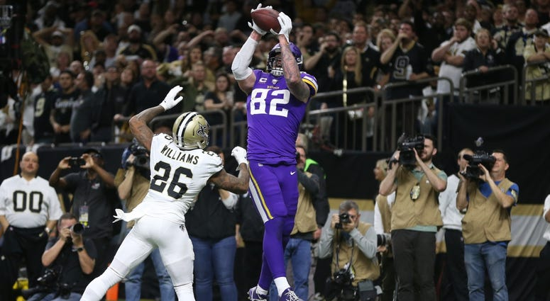 Vikings tight end Kyle Rudolph (82) catches a pass for the winning touchdown over Saints cornerback P.J. Williams (26) in overtime of a wild-card round matchup.