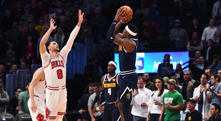 Nuggets forward Torrey Craig (3) attempts a 3-pointer over Bulls guard Zach LaVine (8).