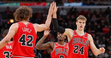 Bulls forward Lauri Markkanen (24) celebrates with center Robin Lopez (42).