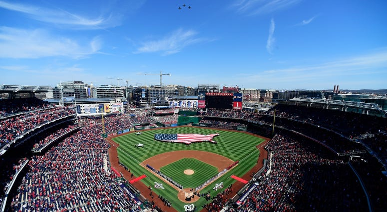 The Nationals and Mets prepare to take the field on Opening Day at Nationals Park.