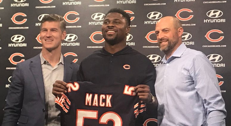 From left, Bears general manager Ryan Pace, pass rusher Khalil Mack and coach Matt Nagy