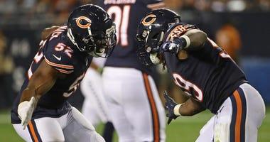 Bears linebacker Khalil Mack, left, and linebacker Danny Trevathan