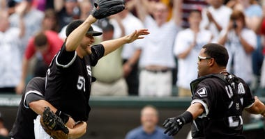White Sox left-hander Mark Buehrle (56) celebrates with teammates Josh Fields (left) and Ramon Castro (27) after throwing a perfect game on July 23, 2009.