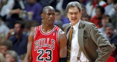 Bulls guard Michael Jordan, left, and coach Phil Jackson in 1995