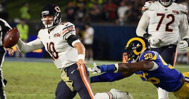 Bears quarterback Mitchell Trubisky (10) tries to scramble away from Rams defensive end Dante Fowler (56).