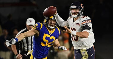 Bears quarterback Mitchell Trubisky (10) throws a pass as he's chased by Rams outside linebacker Clay Matthews.