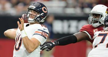 Bears quarterback Mitchell Trubisky, left