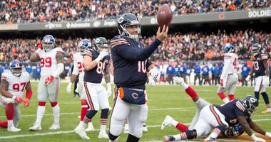 Bears quarterback Mitchell Trubisky (10) celebrates after scoring a touchdown against the New York Giants.