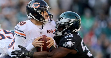 Bears quarterback Mitchell Trubisky (10) is sacked by Eagles defensive end Genard Avery.