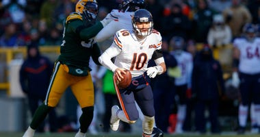 Bears quarterback Mitchell Trubisky (10) rushes with the football against the Packers.