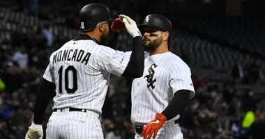 Yonder Alonso (17) celebrates with White Sox teammate Yoan Moncada (10) after homering against the Orioles.