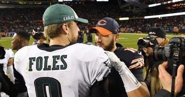 Then-Eagles quarterback Nick Foles (9) greets Bears quarterback Mitchell Trubisky (10) after Philadelphia defeated Chicago in a wild-card round game in January 2019.