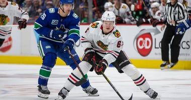 Blackhawks defenseman Olli Maatta skates with the puck against the Canucks.