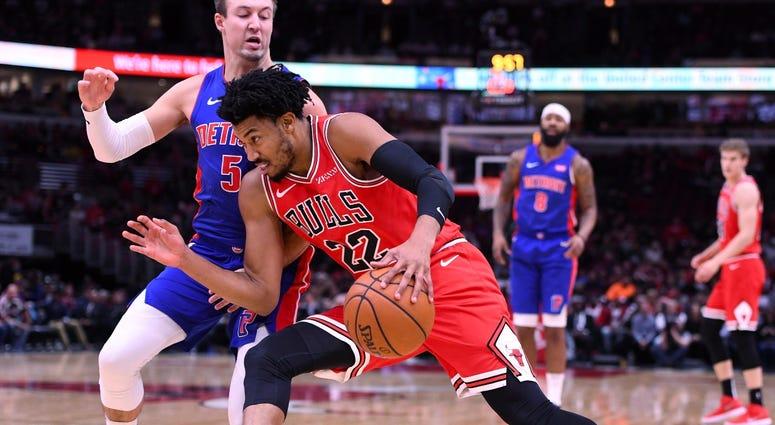Bulls forward Otto Porter Jr. (22) dribbles the ball against Pistons guard Luke Kennard (5).