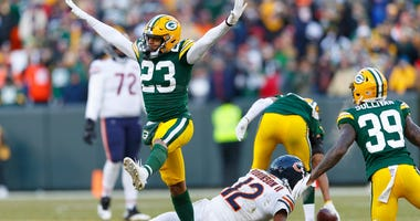 Packers cornerback Jaire Alexander (23) celebrates after defending a pass intended for Bears receiver Allen Robinson II (12).
