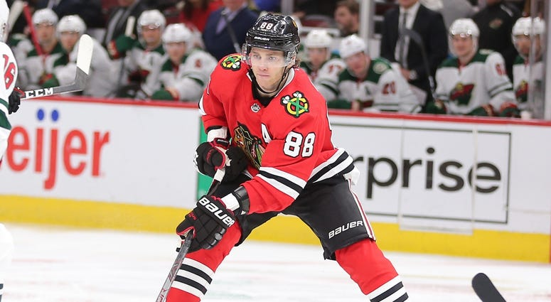 Blackhawks right wing Patrick Kane (88) handles the puck against the Wild.