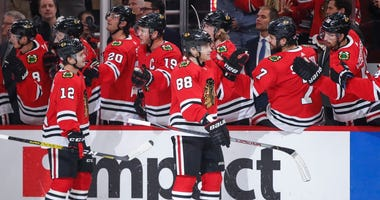 Blackhawks right wing Patrick Kane (88) celebrates with teammates after scoring against the Maple Leafs.