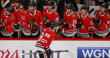 Blackhawks winger Patrick Kane (88) celebrates with teammates after scoring against the Blues.