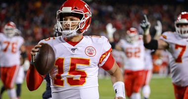 Chiefs quarterback Patrick Mahomes runs for a touchdown against the Bears.