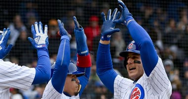 Anthony Rizzo is congratulated by Cubs teammates after homering.