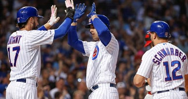 Cubs first baseman Anthony Rizzo (44) celebrates with third baseman Kris Bryant (17) after hitting a homer.