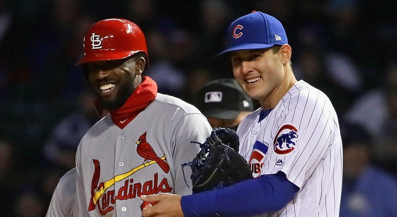 Cardinals outfielder Dexter Fowler, left, and Cubs first baseman Anthony Rizzo