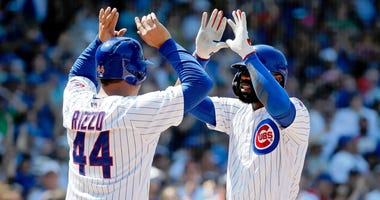 Jason Heyward, right, celebrates with Cubs teammate Anthony Rizzo after homering against the Pirates.