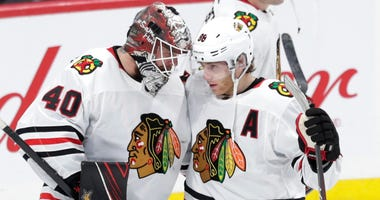 Blackhawks goalie Robin Lehner (40) and winger Patrick Kane (88) celebrate after a win against the Jets.