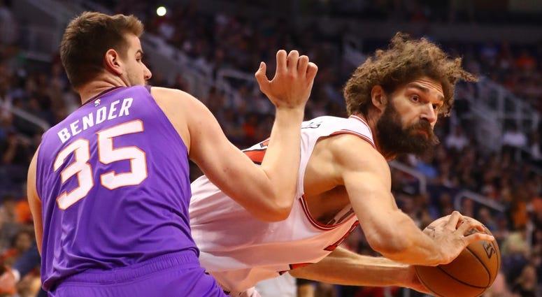 Bulls center Robin Lopez (right) works against Suns forward Dragan Bender (35).