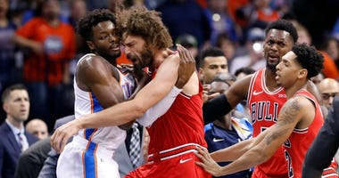 Thunder forward Jerami Grant, left, and Bulls center Robin Lopez get into an argument.