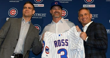 From left, Cubs president of baseball operations Theo Epstein, manager David Ross and general manager Jed Hoyer pose at Ross' introductory press conference.