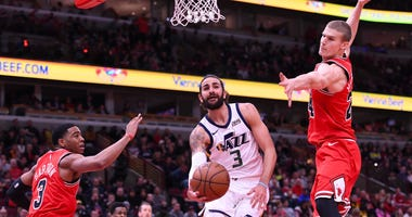 Jazz guard Ricky Rubio (3) makes a pass while being defended by Bulls forward Lauri Markkanen (24) and guard Shaquille Harrison (3).