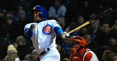 Cubs shortstop Addison Russell bats against the Cardinals.