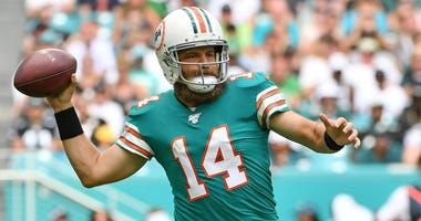 Dolphins quarterback Ryan Fitzpatrick attempts a pass against the Eagles.