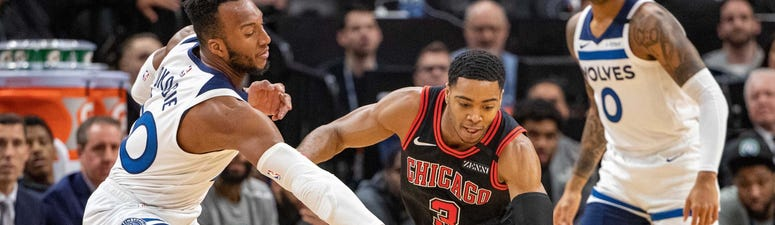 Bulls guard Shaquille Harrison (3) and Timberwolves guard Josh Okogie (20) reach for a loose ball.