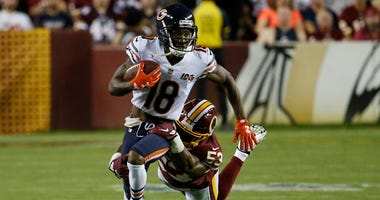 Bears receiver Taylor Gabriel (18) runs after a catch against the Redskins.