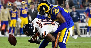 Rams cornerback Jalen Ramsey (20) breaks up a pass to Bears receiver Taylor Gabriel (18).