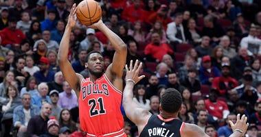 Bulls forward Thaddeus Young (21) shoots against Raptors guard Norman Powell (24).