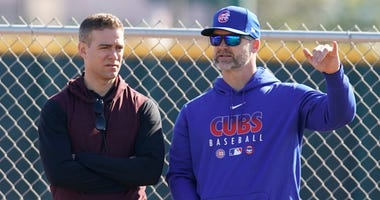 Cubs president of baseball operations Theo Epstein, left, and manager David Ross talk during spring training.