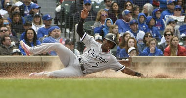 White Sox shortstop Tim Anderson slides home with a run.